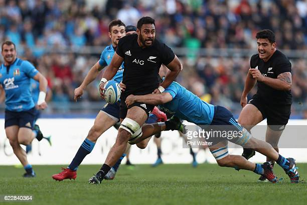 Patrick Tuipulotu of the New Zealand All Blacks is tackled during the international rugby match between New Zealand and Italy at Stadio Olimpico on...