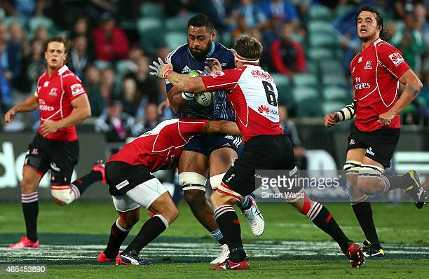Patrick Tuipuluotu of The Blues is tackled during the round four Super Rugby match between the Blues and the Lions at QBE Stadium on March 7 2015 in...