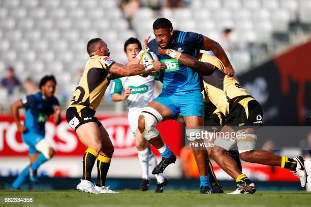 Patrick Tupulotu of the Blues is tackled during during the round six Super Rugby match between the Blues and the Force at Eden Park on April 1 2017...