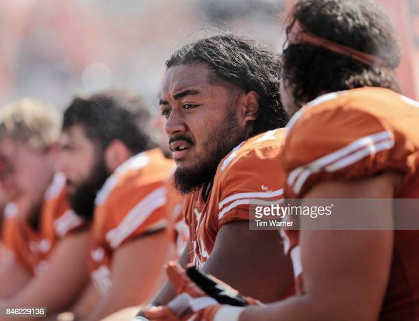 Patrick Vahe of the Texas Longhorns rests on the sideline in the second half against the San Jose State Spartans at Darrell K RoyalTexas Memorial...