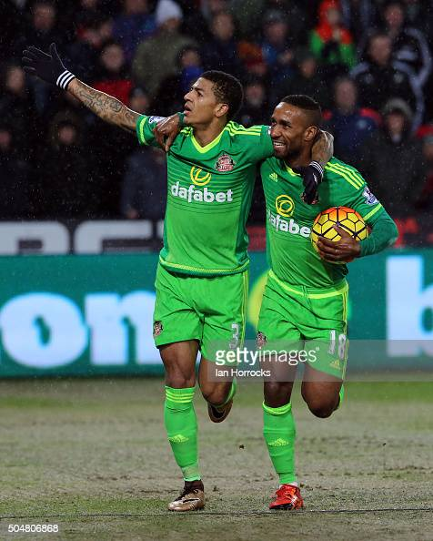 Patrick Van Aanholt celebrates scoring the second Sunderland goal during the Barclays Premier League Match between Swansea City and Sunderland at The...