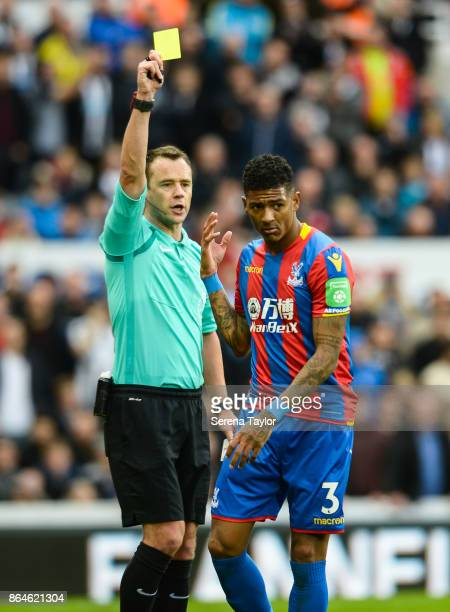 Patrick Van Aanholt of Crystal Palace isn't happy after Referee Stuart Attwell shows him a yellow card during the Premier League match between...