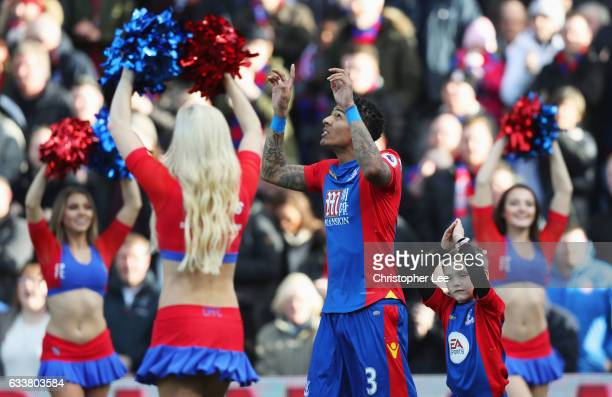 Patrick van Aanholt of Crystal Palace points towards the sky prior to kick off prior to the Premier League match between Crystal Palace and...