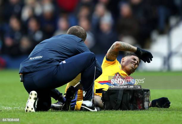 Patrick van Aanholt of Crystal Palace receives treatment from the medical team during the Premier League match between West Bromwich Albion and...