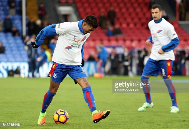 Patrick van Aanholt of Crystal Palace warms up wearing a Pride and Palace tshirt prior to the Premier League match between Crystal Palace and...