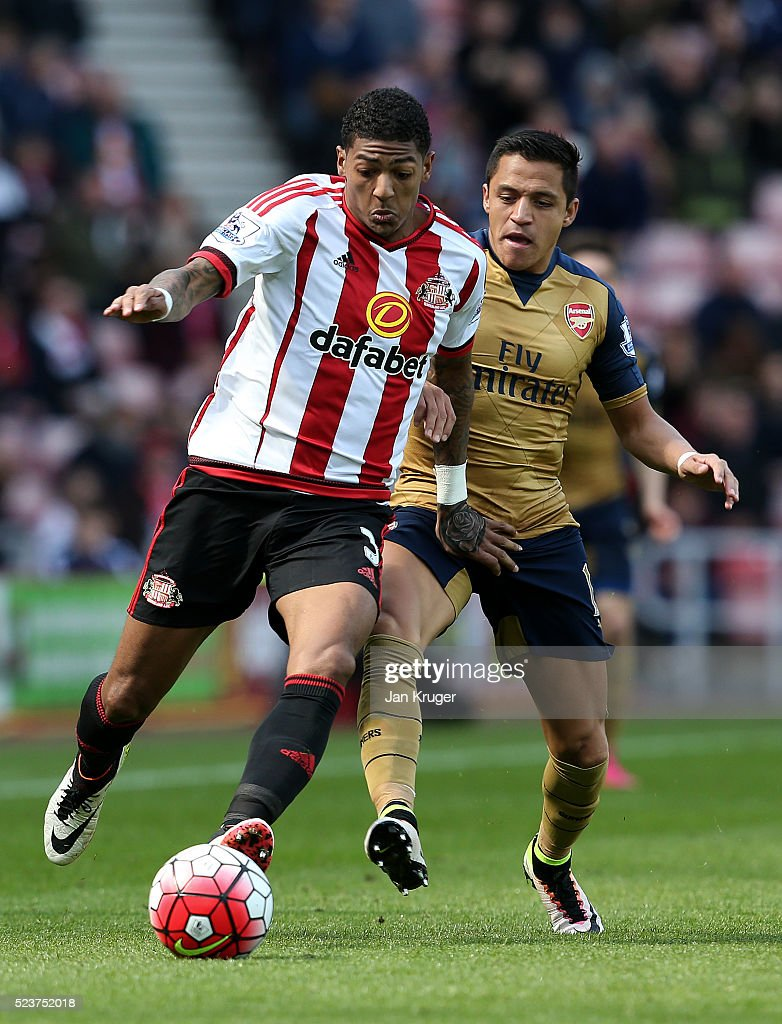Patrick van Aanholt of Sunderland and Alexis Sanchez of Arsenal battle for the ball during the Barclays Premier League match between Sunderland and...