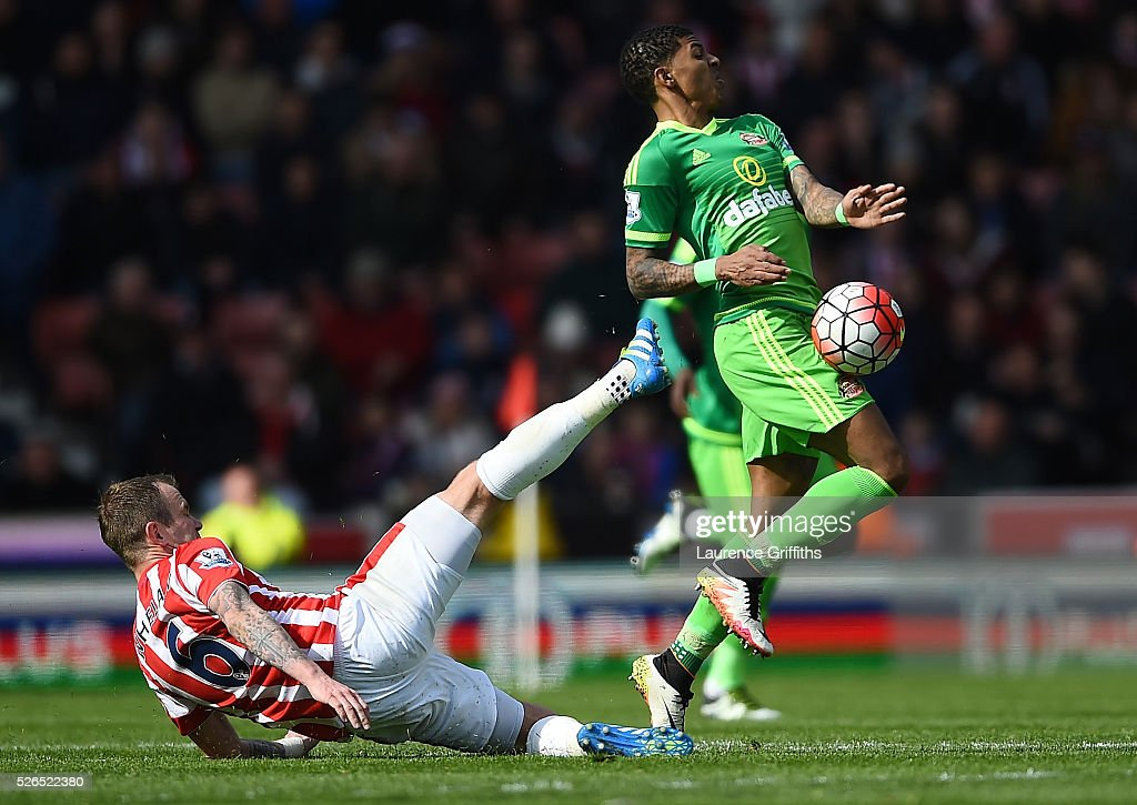Patrick van Aanholt of Sunderland and Glenn Whelan of Stoke City compete for the ball during the Barclays Premier League match between Stoke City and Sunderland at the Britannia Stadium on April 30, 2016 in Stoke on Trent, England.