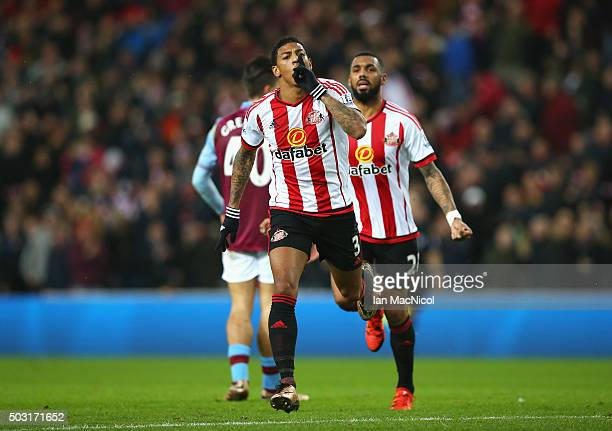 Patrick van Aanholt of Sunderland celebrates scoring his team's first goal during the Barclays Premier League match between Sunderland and Aston...