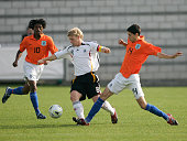 Patrick van Aanholt of the Netherlands tackles Patrick Funk of Germany during the 2007 UEFA European Under 17 Championship fifth place match between...