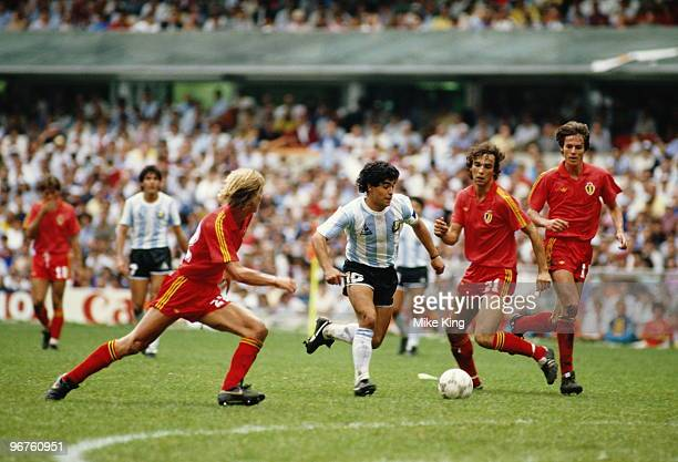 Patrick Vervoort of Belgium closes in on Diego Maradona of Argentina as Stefan Demol of Belgium looks on during the 1986 FIFA World Cup Semi Final on...