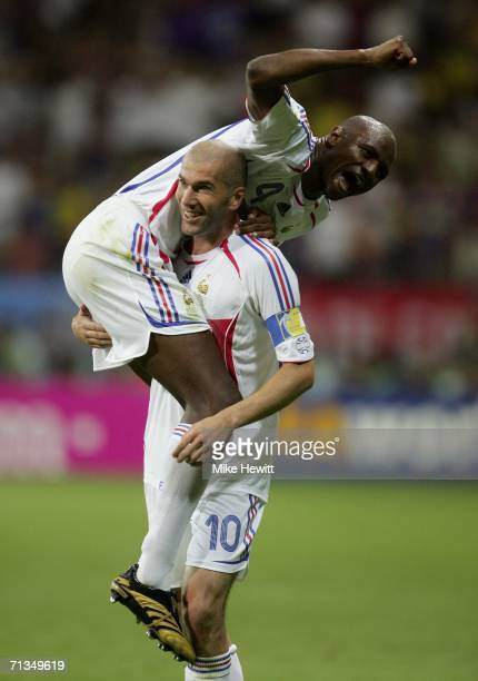 Patrick Vieira and Zinedine Zidane of France celebrate after teammate Thierry Henry scores the opening goal during the FIFA World Cup Germany 2006...