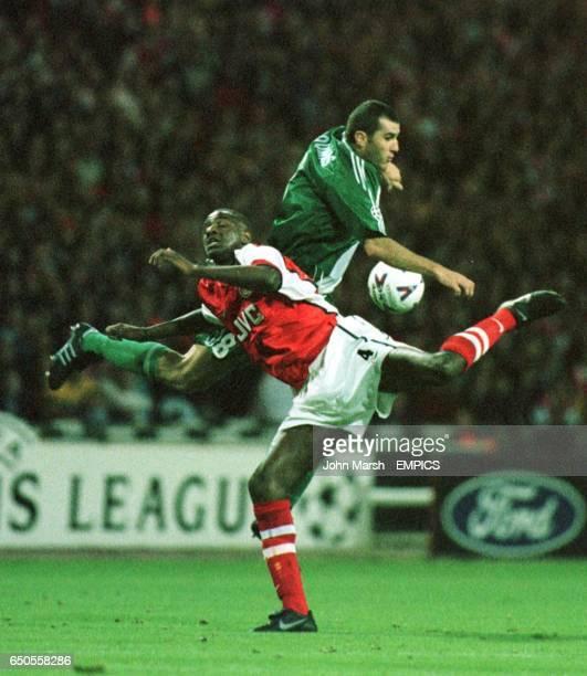 Patrick Vieira of Arsenal and Ioannis Goumas of Panathinaikos battle for the ball