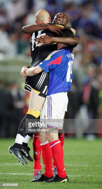 Patrick Vieira of France hugs his team mates Fabien Barthez and Willy Sagnol during the France v England Group B match in the 2004 UEFA European...