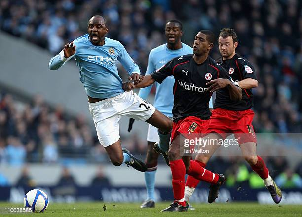 Patrick Vieira of Manchester City falls to the ground after being challenged by Mikele Leigertwood of Reading during the FA Cup sponsored by EOn...