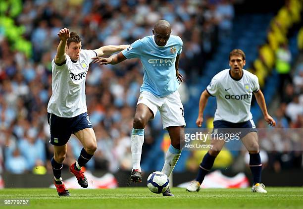 Patrick Vieira of Manchester City holds off the challenge from James Milner of Aston Villa during the Barclays Premier League match between...