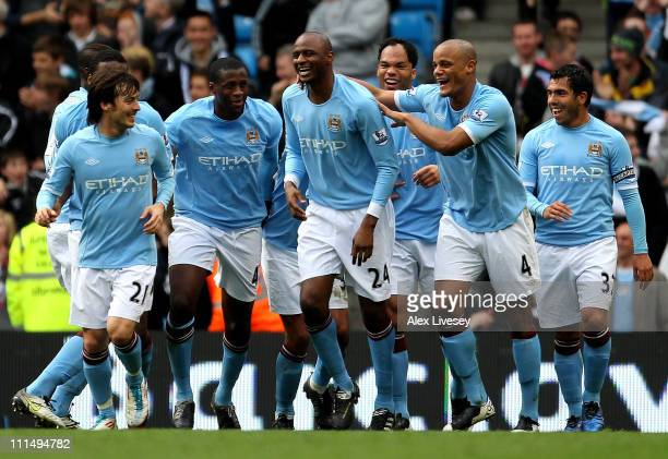 Patrick Vieira of Manchester City is congratulated by his team mates after scoring his team's fourth goal during the Barclays Premier League match...