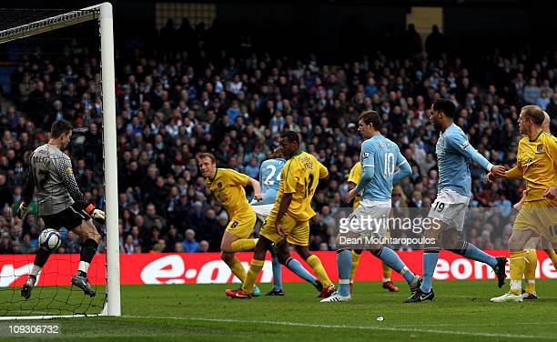 Patrick Vieira of Manchester City scores the opening goal past Stuart Nelson of Notts County during the FA Cup sponsored by EOn 4th Round replay...