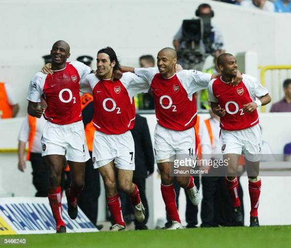Patrick Vieira Robert Pires Thierry Henry and Ashley Cole of Arsenal celebrate after the second goal during the FA Barclaycard Premiership match...