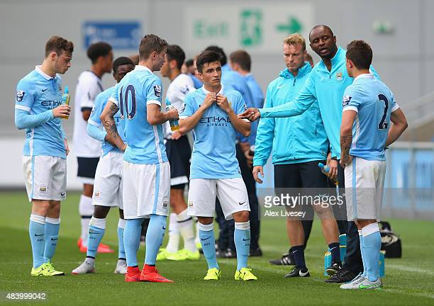 Patrick Vieira the coach of Manchester City U21 talks to his players during the Barclays U21 Premier League match between Manchester City U21 and...