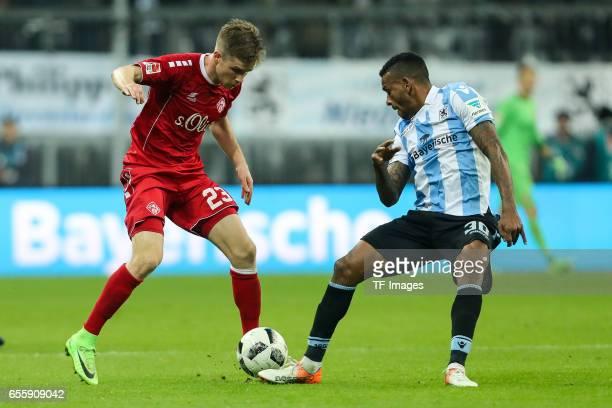 Patrick Weihrauch of FC Wuerzburger Kickers und Amilton Minervino da Silva of 1860 Munich battle for the ball during the Second Bundesliga match...