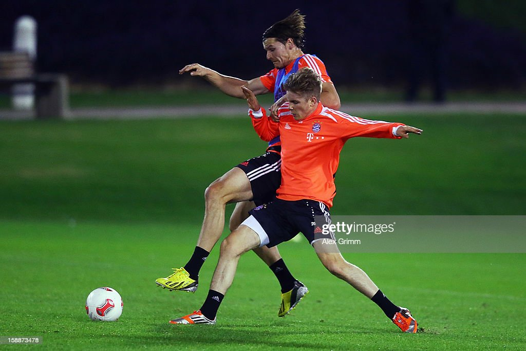 Patrick Weihrauch (front) of Muenchen is challenged by Daniel van Buyten during a Bayern Muenchen training session at the ASPIRE Academy for Sports Excellence on January 2, 2013 in Doha, Qatar.