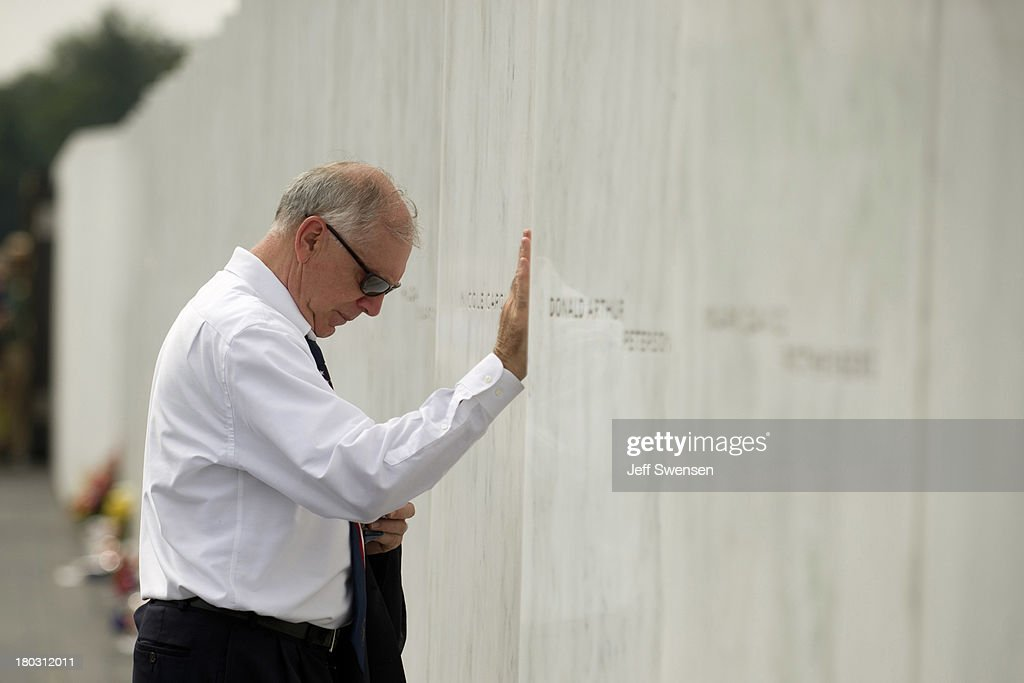 Patrick White, a relative of crash victim Louis Nacke, pauses at his name at the Flight 93 National Memorial during ceremonies commemorating the 12th anniversary of the 9/11 attacks on September 11, 2013 in Shanksville, Pennsylvania. The nation is commemorating the anniversary of the 2001 attacks, which resulted in the deaths of nearly 3,000 people after two hijacked planes crashed into the World Trade Center, one into the Pentagon in Arlington, Virginia and one crash landed in Shanksville, Pennsylvania.