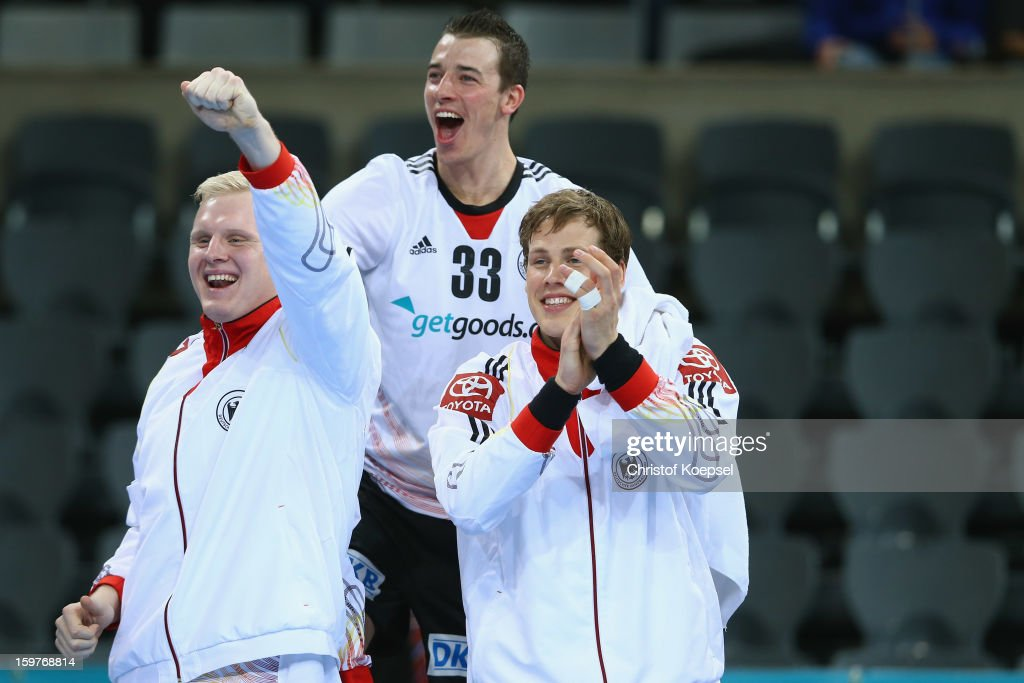 Patrick Wiencek, Dominik Klein and Sven-Soeren Christophersen of Germany celebrate the 28-23 victory after the round of sixteen match between Germany and Macedonia at Palau Sant Jordi on January 20, 2013 in Barcelona, Spain.