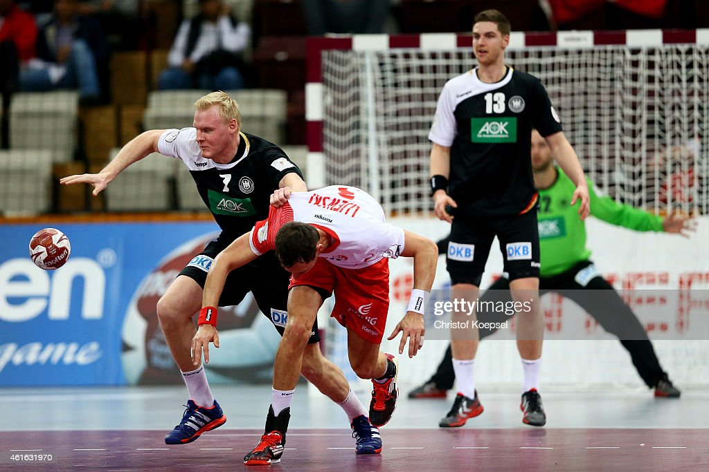 Patrick Wiencek of Germany and Krzystof Lijewski of Poland fight for the ball during the IHF Men's Handball World Championship group D match between...