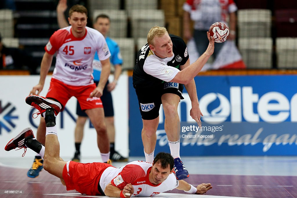 Patrick Wiencek of Germany (R) challenges Krzystof Lijewski of Poland (L) during the IHF Men's Handball World Championship group D match between Poland and Germany at Lusail Multipurpose Hall on January 16, 2015 in Doha, Qatar.