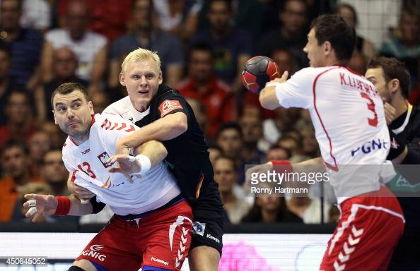 Patrick Wiencek of Germany copmetes with Bartosz Jurecki and Krzysztof Lijewski of Poland during the IHF World Championship 2015 Playoff Leg Two...
