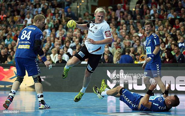 Patrick Wiencek of Germany in action against Rene Toft Hansen and Christian Zeitz of the Allstars during the All Star Game 2014 between Germany and...