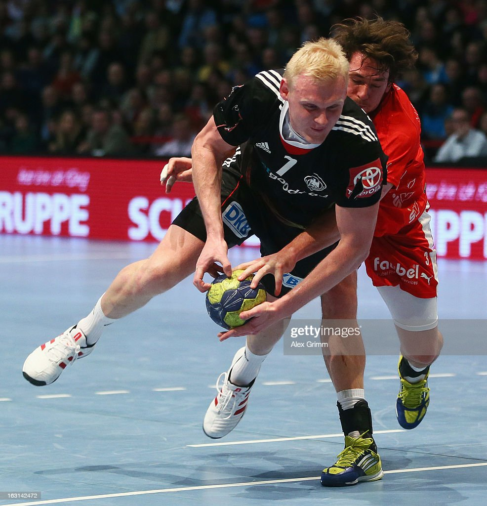 Patrick Wiencek (front) of Germany is challenged by Jonathan Stenbacken of Melsungen during a benefit match between the German national handball team and MT Melsungen at Rothenbach-Halle on March 5, 2013 in Kassel, Germany.