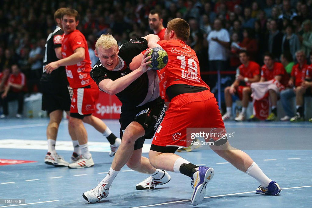 Patrick Wiencek (L) of Germany is challenged by Max Pregler of Melsungen during a benefit match between the German national handball team and MT Melsungen at Rothenbach-Halle on March 5, 2013 in Kassel, Germany.