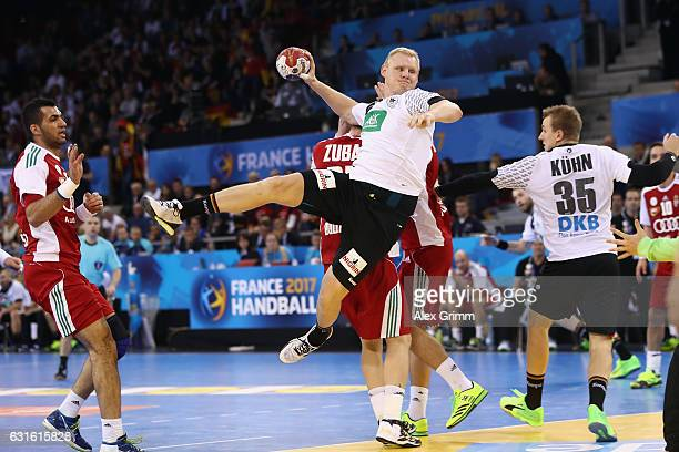 Patrick Wiencek of Germany jumps with the ball during the 25th IHF Men's World Championship 2017 match between Germany and Hungary at Kindarena on...