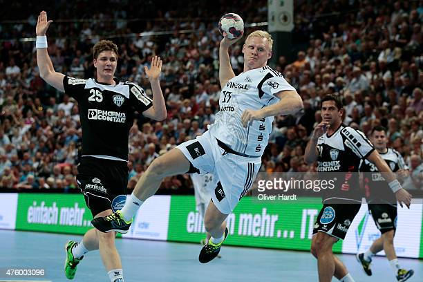 Patrick Wiencek of Kiel challenges for the ball with Finn Lemke of Lemgo during the DKB HBL Bundesliga match between THW Kiel and TBV Lemgo at...