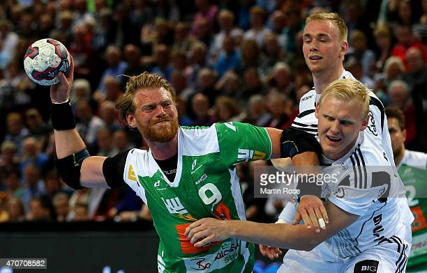 Patrick Wiencek of Kiel challenges for the ball with Manuel Spaeth of Goeppingen during the DKB HBL Bundesliga match between THW Kiel and Frisch Auf...
