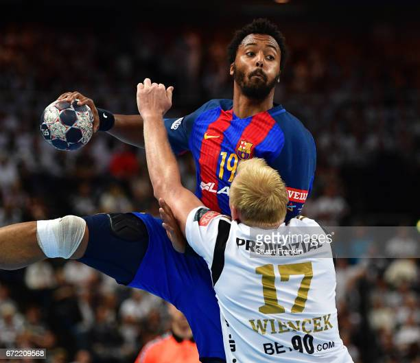 Patrick Wiencek of Kiel challenges Timothey N'Guessan of Barcelona during the EHF Champions League Quarter Final first leg match between THW Kiel and...