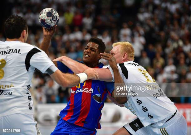 Patrick Wiencek of Kiel challenges Wael Jallouz of Barcelona during the EHF Champions League Quarter Final first leg match between THW Kiel and...