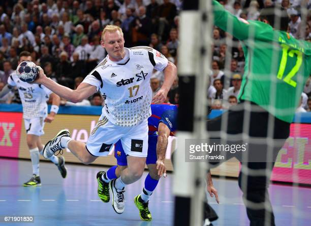Patrick Wiencek of Kiel throws a goal during the EHF Champions League Quarter Final first leg match between THW Kiel and Barcelona at the Sparkasse...