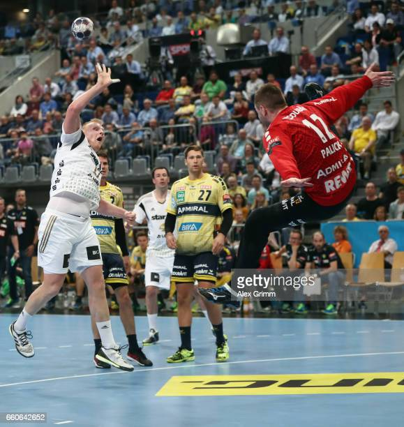 Patrick Wiencek of Kiel throws the ball over Goalkeeper Andreas Palicka of RheinNeckar Loewen during the EHF Champions League Quarter Final Leg 2...