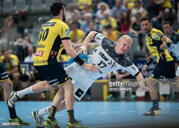 Patrick Wiencek of Kiel tries to score against Gedeon Guardiola Villaplana of RheinNeckar Loewen during the DKB HBL match between RheinNeckar Loewen...
