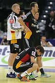 Patrick Wiencek Pascal Hens and Uwe Gensheimer of Germany look dejcted after losing 3233 the Men's European Handball Championship second round group...
