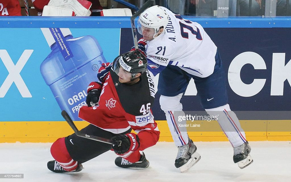 Patrick Wiercioch of Canada and Antoine Roussel of France during the 2015 IIHF World Championship between France and Canada at O2 arena on May 92015...