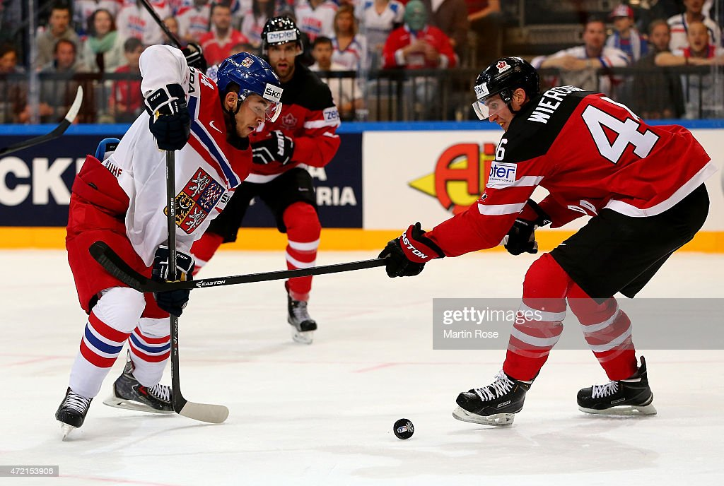 Patrick Wiercioch of Canada and Dominik Simon of Czech Republic battle for the puck during the IIHF World Championship group A match between Canada...