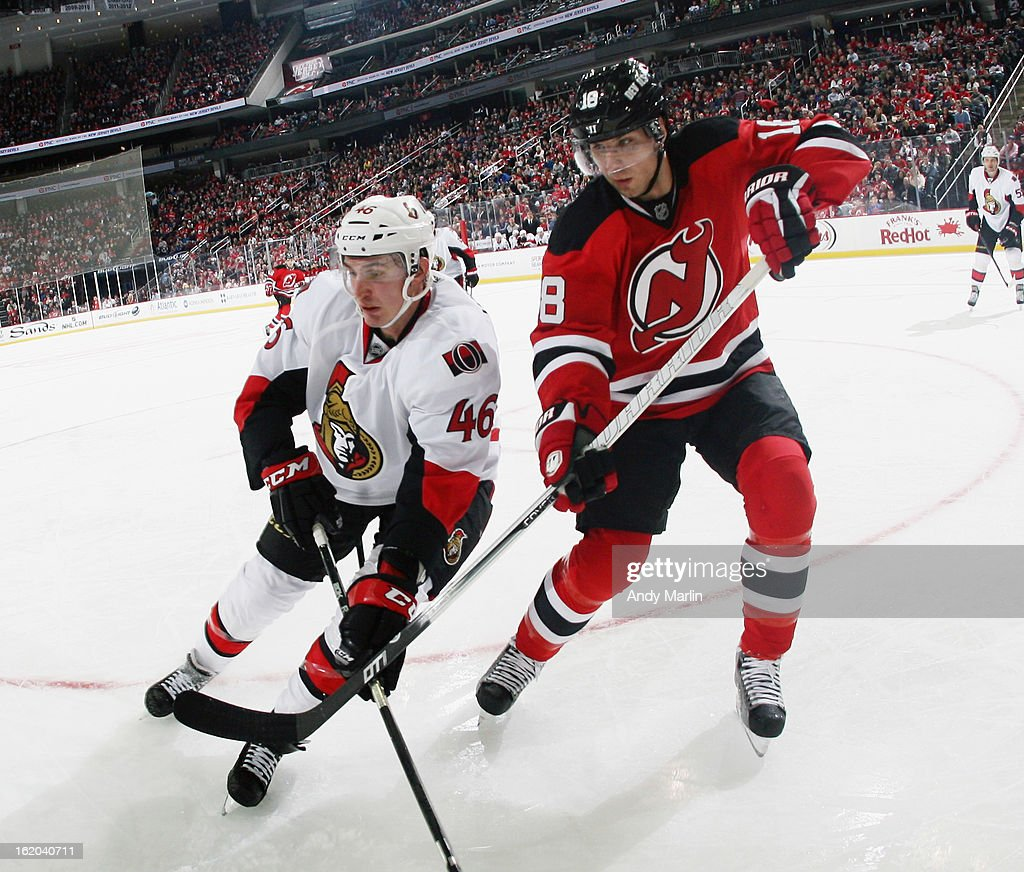 Patrick Wiercioch #46 of the Ottawa Senators and Steve Bernier #18 of the New Jersey Devils battle for position near the corner during the game at the Prudential Center on February 18, 2013 in Newark, New Jersey.