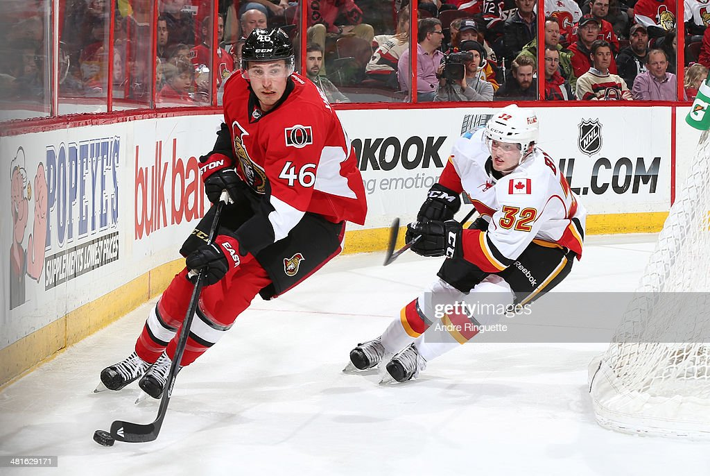 <a gi-track='captionPersonalityLinkClicked' href=/galleries/search?phrase=Patrick+Wiercioch&family=editorial&specificpeople=5408887 ng-click='$event.stopPropagation()'>Patrick Wiercioch</a> of the Ottawa Senators controls the puck behind the net against pressure from <a gi-track='captionPersonalityLinkClicked' href=/galleries/search?phrase=Paul+Byron+-+Ice+Hockey+Player&family=editorial&specificpeople=4535697 ng-click='$event.stopPropagation()'>Paul Byron</a> #32 of the Calgary Flames at Canadian Tire Centre on March 30, 2014 in Ottawa, Ontario, Canada.