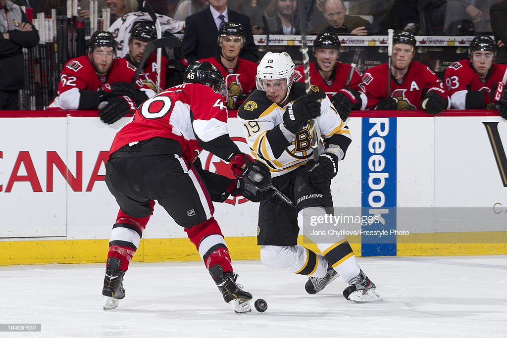 Patrick Wiercioch #46 of the Ottawa Senators defends against a puck carrying Tyler Seguin #19 of the Boston Bruins, during an NHL game, at Scotiabank Place, on March 21, 2013 in Ottawa, Ontario, Canada.