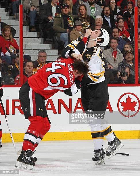 Patrick Wiercioch of the Ottawa Senators fights with Adam McQuaid of the Boston Bruins during first period action on March 11 2013 at Scotiabank...