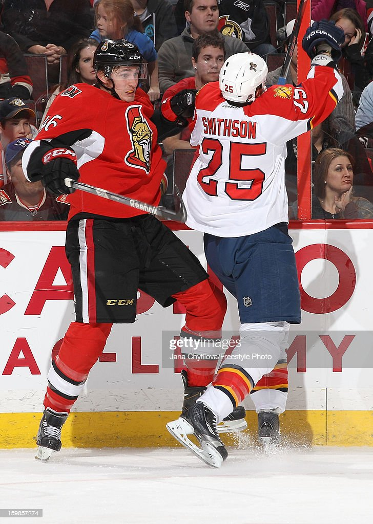 Patrick Wiercioch #46 of the Ottawa Senators gets checked against the boards by <a gi-track='captionPersonalityLinkClicked' href=/galleries/search?phrase=Jerred+Smithson&family=editorial&specificpeople=224622 ng-click='$event.stopPropagation()'>Jerred Smithson</a> #25 of the Florida Panthers during an NHL game at Scotiabank Place on January 21, 2013 in Ottawa, Ontario, Canada.