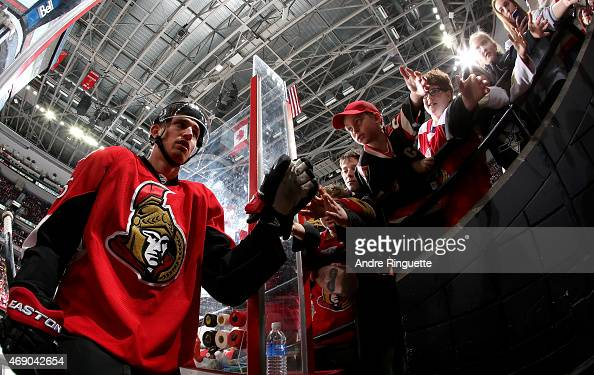 Patrick Wiercioch of the Ottawa Senators highfives fans as he leaves the ice after warmup prior to a game against the Pittsburgh Penguins at Canadian...